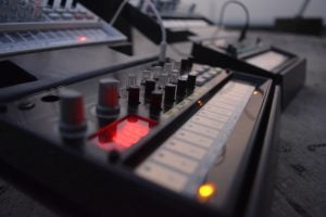 Audio and visual equipment with dials, lights and buttons