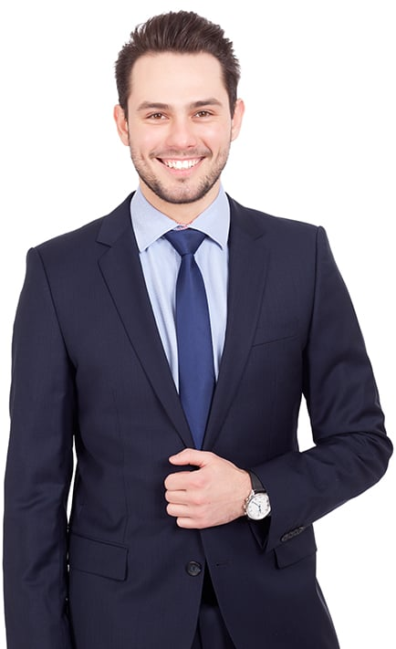 An accountant in a navy blue suit smiling at the camera
