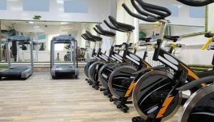 A row of spinning bikes and treadmills in a newly fitted out gym