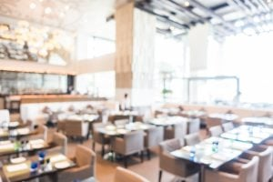 A recently refurbished restaurant with high ceilings and luxury furniture