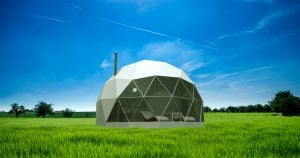 Dome camping structure in a field, designed and produced by truDomes